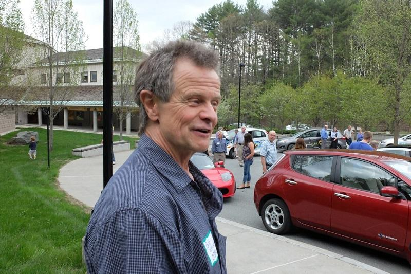 Bob Walker, of the Sustainable Energy Resource Group, greets visitors to an electric car rally at the Montshire Museum.