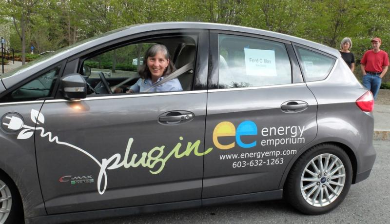 Kim Quirk offers test drives in her Ford C-Max electric car at a rally at the Montshire Museum..