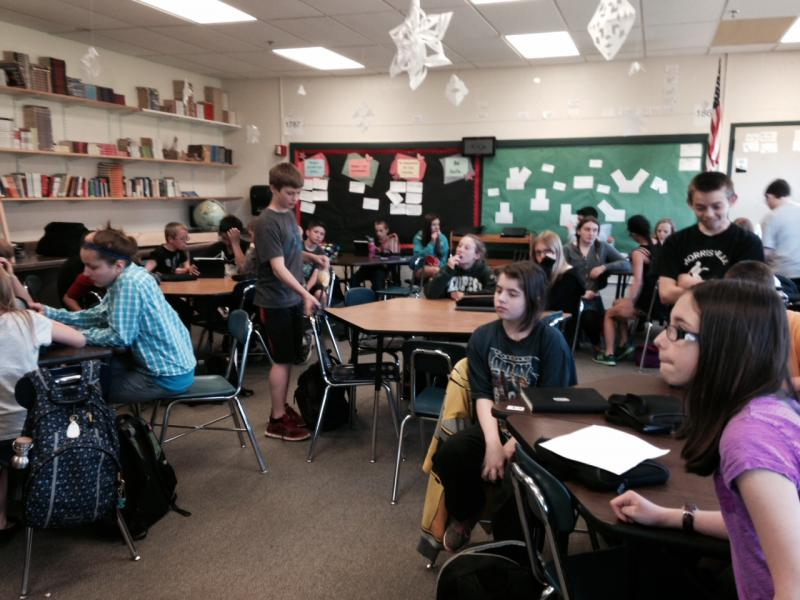 Middle school students work in small groups in Maura Kelly's Social Studies class.