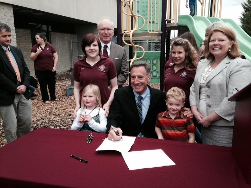 Gov. Peter Shumlin signs the universal pre-K bill in Rutland on Wednesday.