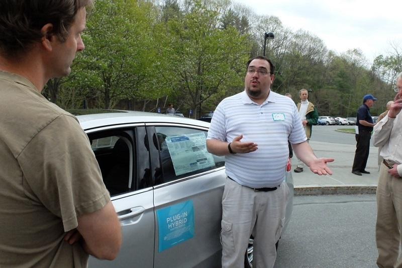 Tim Letourneau, of Lamoille Valley Ford, gives a sales pitch for the Ford Fusion Energi at a rally at the Montshire Museum.