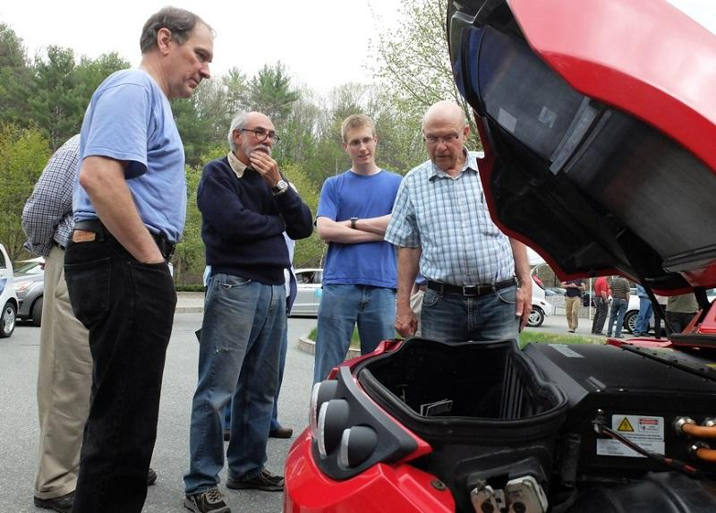 """Henry """"Tofer"""" Sharp of Thetford shows off his all-electric Tesla roadster at a rally at the Montshire Museum."""