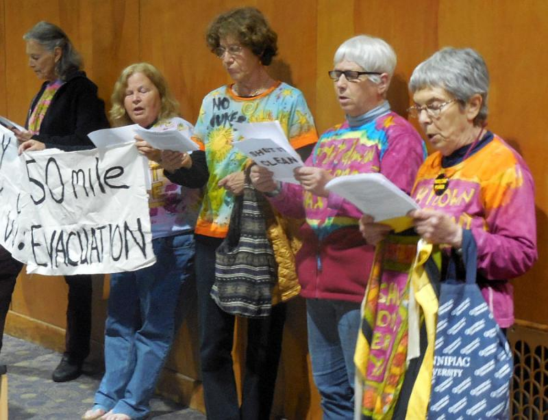 A group of protestors from Massachusetts reads a letter criticizing an NRC ruling on spent fuel storage.
