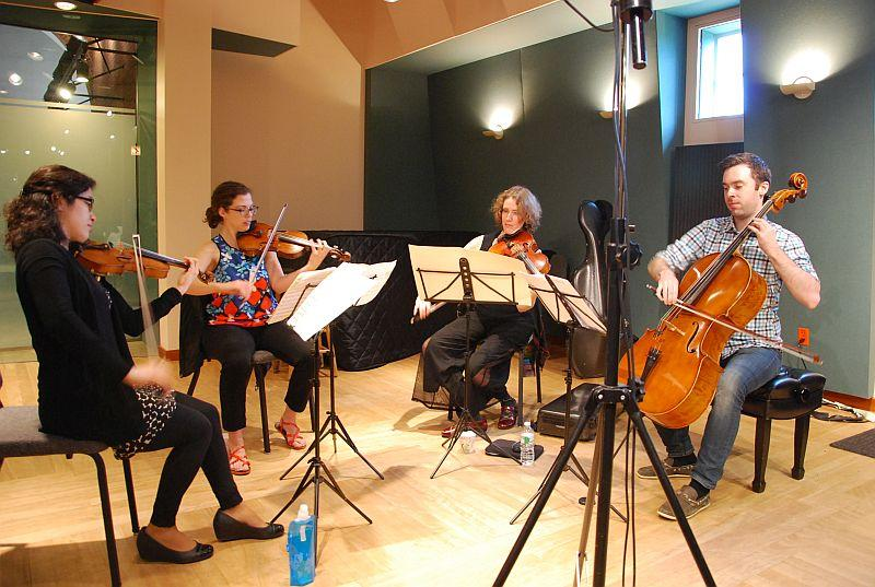 The Momenta Quartet warms up in the VPR Performance Studio prior to their live performance