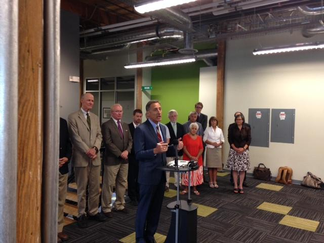 Gov. Peter Shumlin signed an economic development bill at MyWebGrocer offices in Winooski Tuesday.