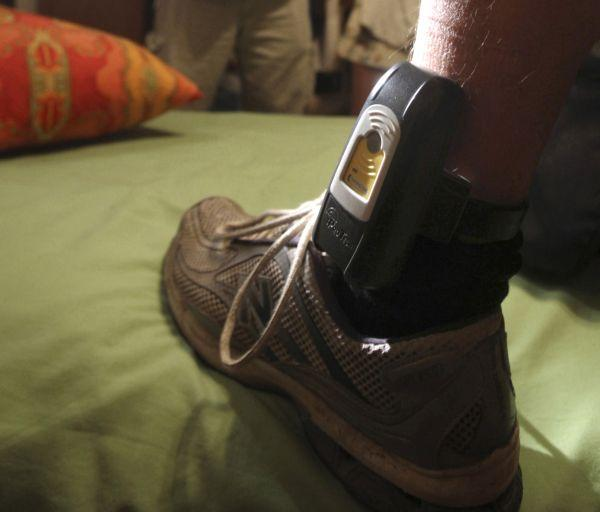 A new pilot program will keep tabs on offenders with electronic monitoring bracelets, seen in the Associate Press file photo.