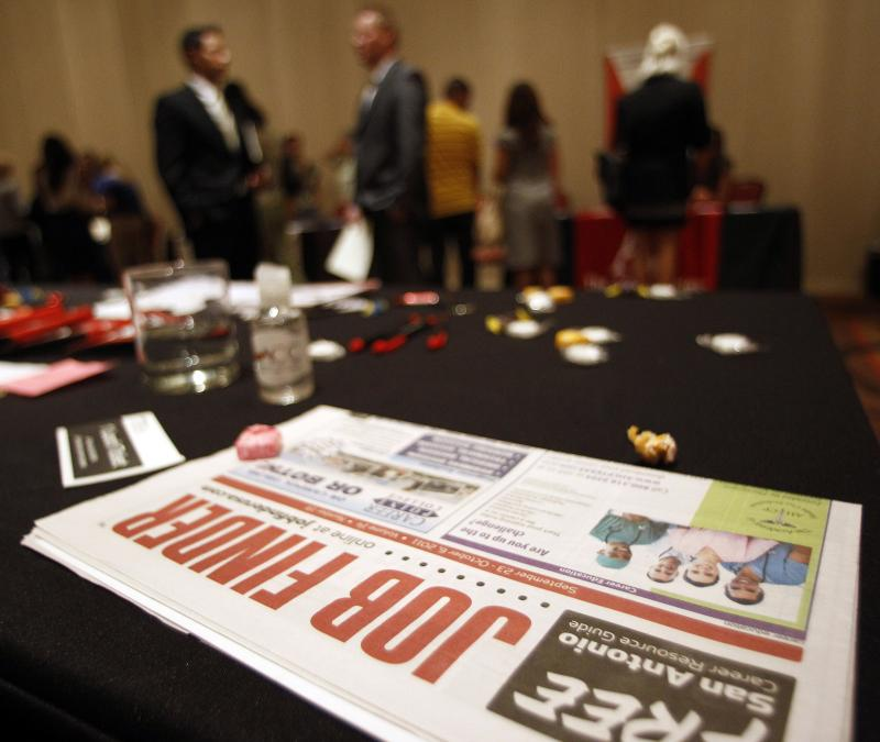 Prospective employees and vendors attend a job fair in 2011.