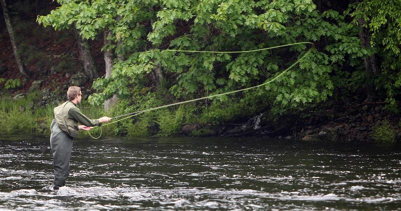 Justin Jones fly fishes for trout on the Contoocook River, Wednesday, May 29, 2013 in Henniker, N.H.