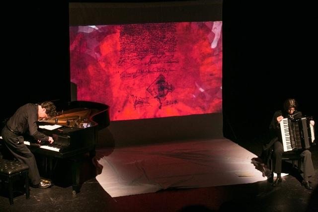 Pianist Seth Knopp performs in front of a video art projection created by Bart Woodstrup.