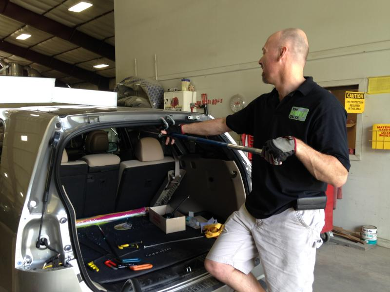 "Dan Ushinski is one of dozens of PDR technicians, better known as ""dent guys,"" who will be repairing hail damage in Rutland in the coming months."