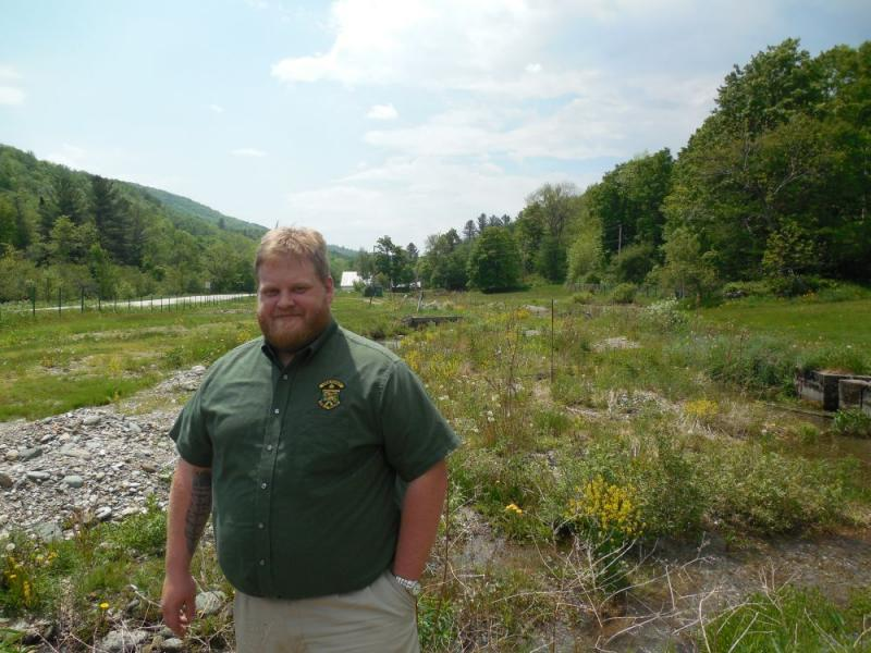 Behind fish Culture Operations Manager Adam Miller was one of the Roxbury fish hatchery's ponds, now filled with gravel and silt.