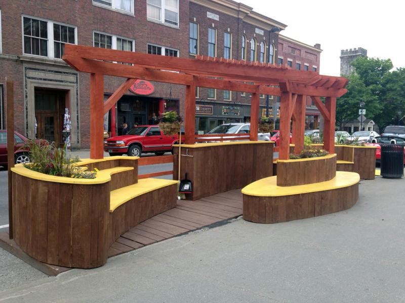 Parklets, or micro-parks, can enhance the downtown experience for pedestrians and cyclists. Montpelier's new parklet is on State Street.