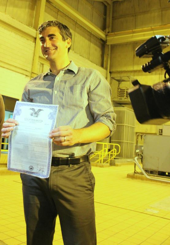 Burlington Mayor Miro Weinberger posed with the city's 30-year bond for the McNeil Generating Station before burning it in the station's furnace.