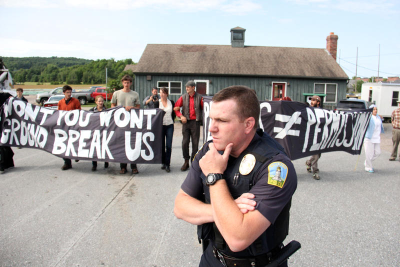 Police were on the scene as pipeline protestors stood and left the Vermont Gas Systems pipe yard.