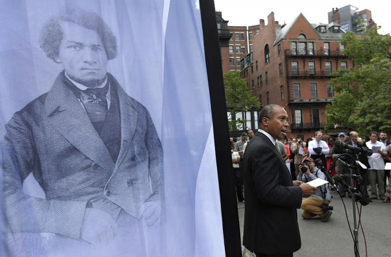 Massachusetts Gov. Deval Patrick, right, stands next to a likeness of abolitionist leader Frederick Douglass, left, while participating in a community reading of the Emancipation Proclamation on the Boston Common, in Boston, Tuesday, July 2, 2013.