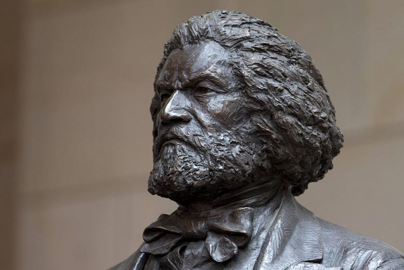 A bronze statue of 19th-century orator and writer Frederick Douglass is seen in the Emancipation Hall of the United States Visitor Center on Capitol Hill in Washington, Wednesday, June 19, 2013, where it was dedicated.