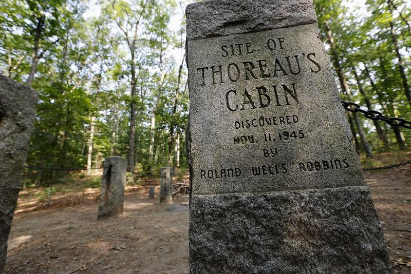 In this photo taken Friday, July 13, 2012, stone pillars delineate the actual site of Henry David Throeau's cabin on the shores of Walden Pond in Concord, Mass.