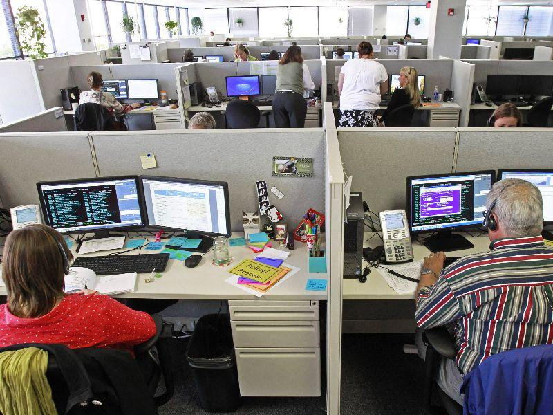 In this 2013 file photo, workers at the Vermont Health Connect call center talk to customers in Burlington.