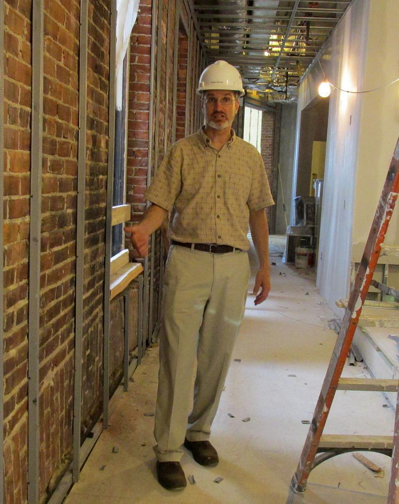 Development partner Bob Stevens leads a tour of the nearly renovated building.
