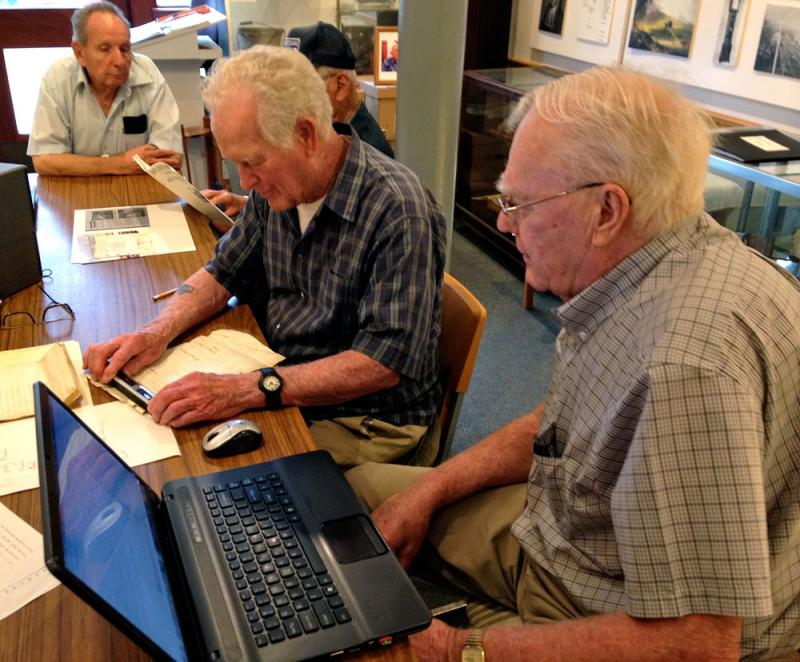 Volunteers Mickey Kelly and Clifford Griffin scan original civil war documents at the Rutland Historical Sciety.