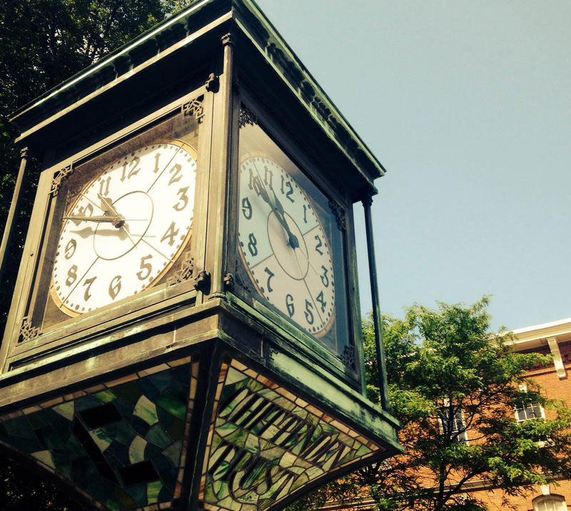 Morning sun shines on Bennington Four Corners clock on July 14.