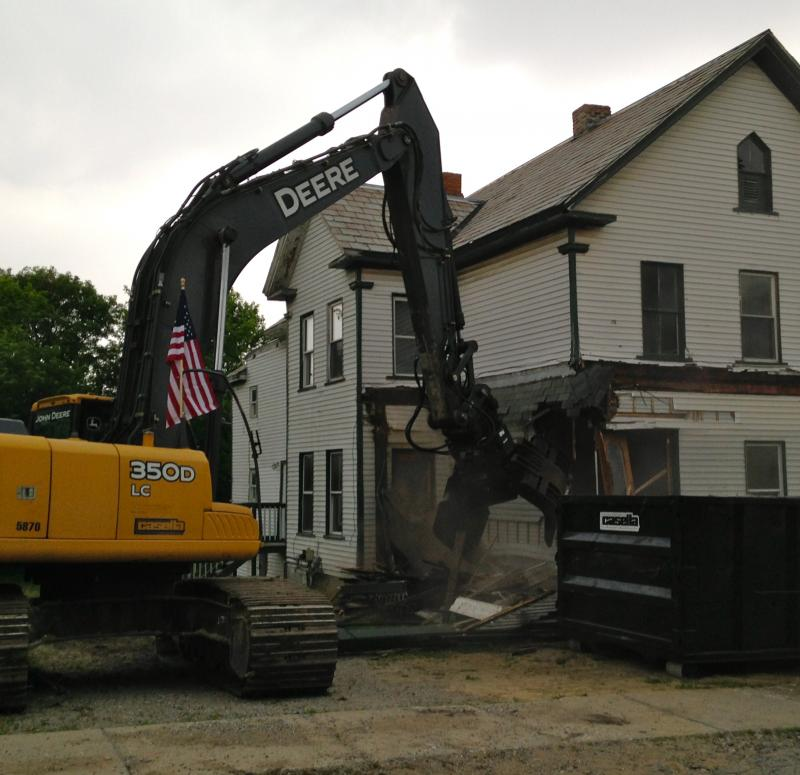 Demolition equipment tears down a vacant apartment building in Rutland's northwest neighborhood. City officials announced a new $1.25 million effort to remove blighted properties and replace them with single family homes and green space.