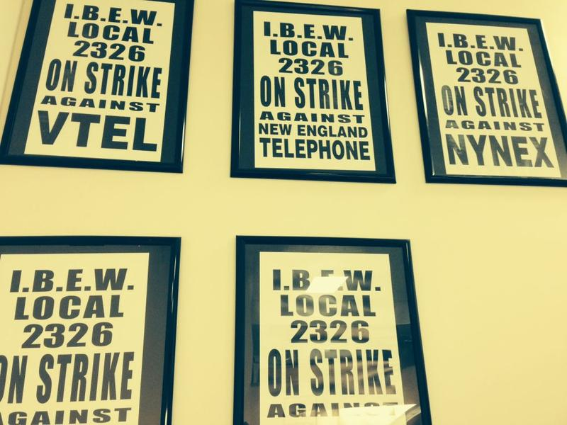 Signs showing past labor actions cover the wall of IBEW spokesman Mike Spillane's office.