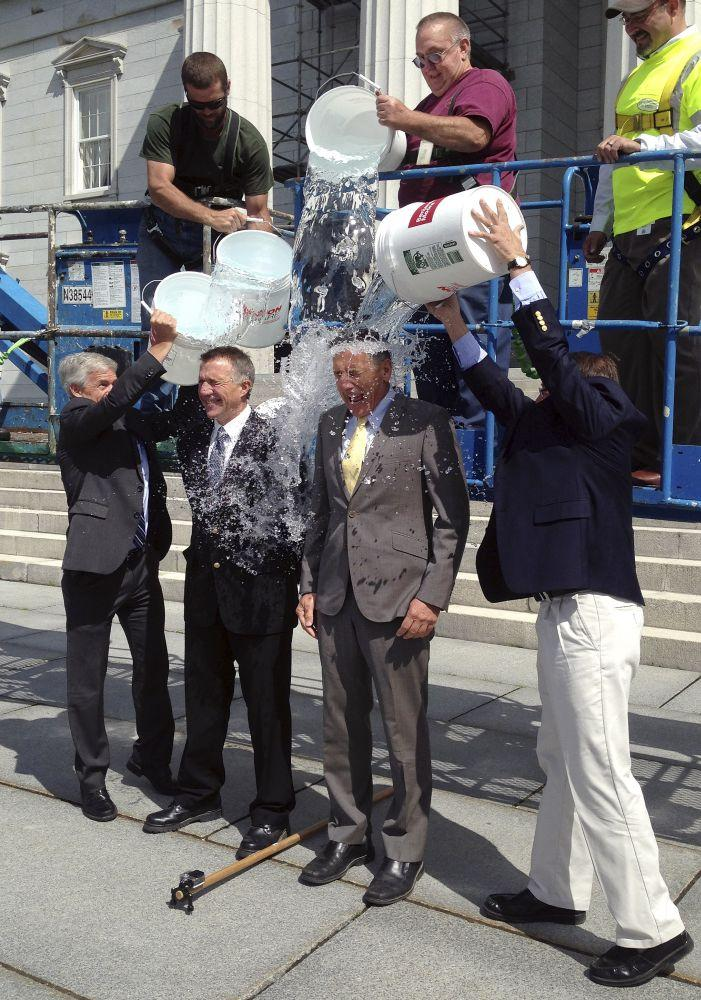 "Lt. Gov. Phil Scott, second from left, and Gov. Peter Shumlin, second from right, take the ""ice bucket challenge"" on Aug. 14, 2014. The challenge is aimed at raising funds to fight ALS, also known as Lou Gehrig's disease."