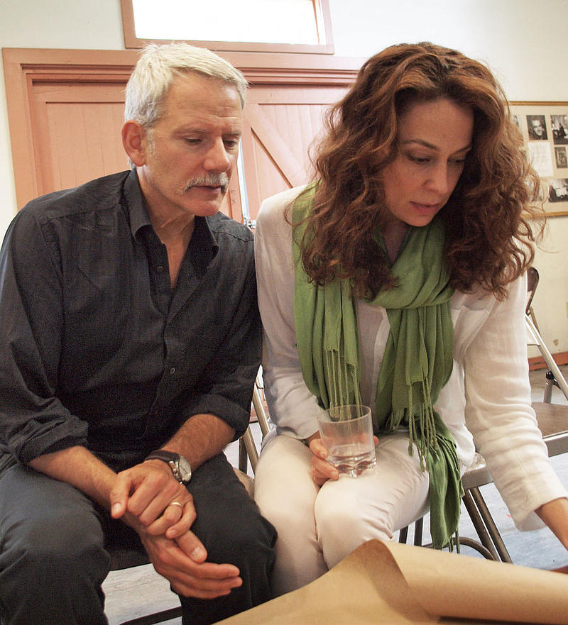Actors Campbell Scott and Kathleen McElfresh review the updated script.