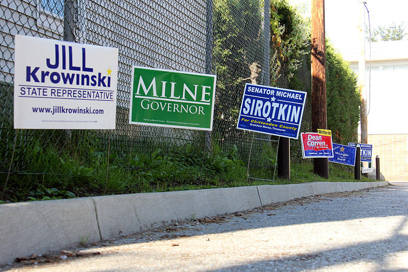 Signs for candidates line the parking lot outside a polling place in Burlington on Tuesday morning.