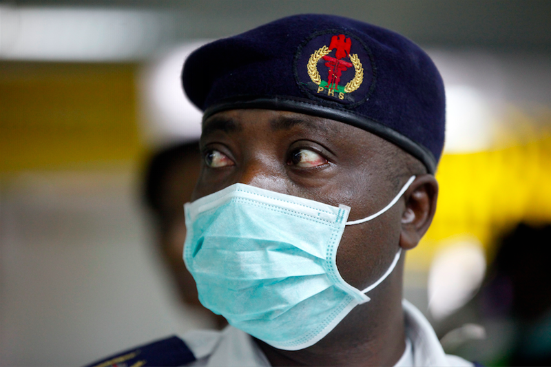 A Nigerian health official wears a protective mask on Aug. 4, 2014. Though the chances of contracting the disease outside of West Africa are extremely slim, American hospitals are preparing for a possible outbreak.