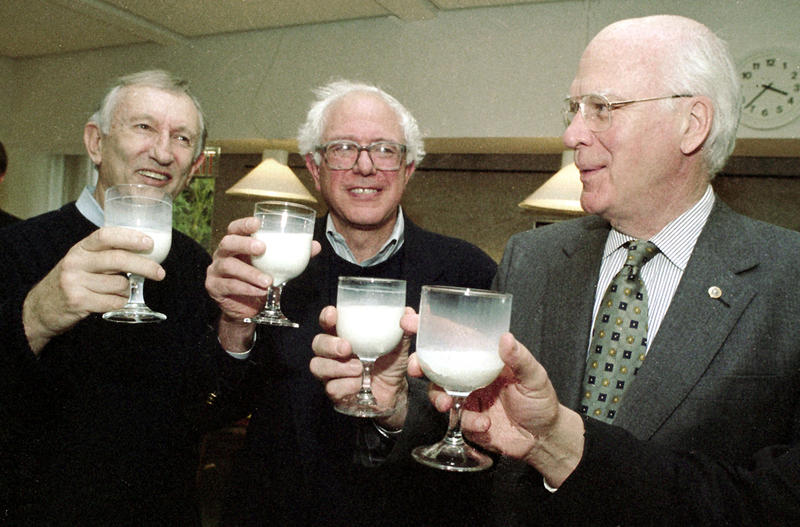 From left, Sen. Jim Jeffords, Rep. Bernie Sanders and Sen. Patrick Leahy celebrate the passing of the Northeast Dairy Compact in Montpelier on Nov. 22, 1999.