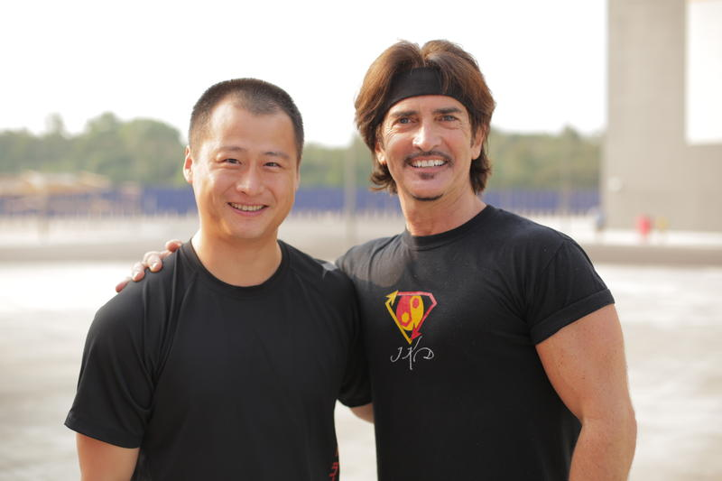 John Fusco (right) with his friend, the stunt man Ju Kun, who was among the passengers who disappeared on Malaysian Airlines flight 370.