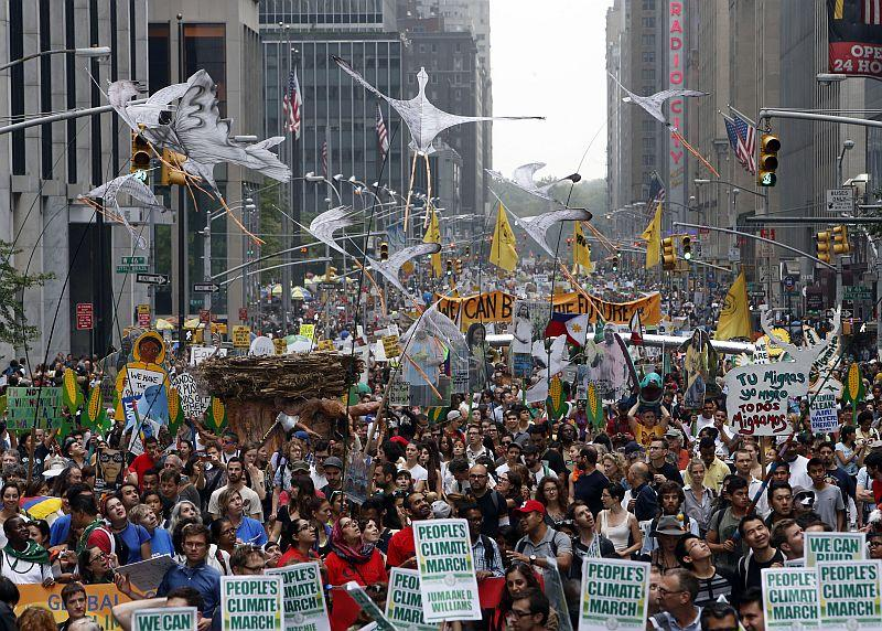 Demonstrators make their way down Sixth Avenue in New York during the People's Climate March Sunday. The march, along with similar gatherings scheduled in other cities worldwide, comes two days before the United Nations Climate Summit.