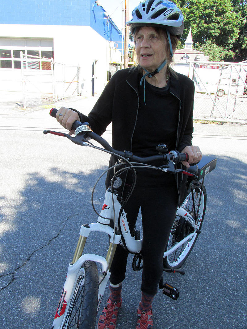 Brattleboro Representative  Mollie Burke tries an e-bike.