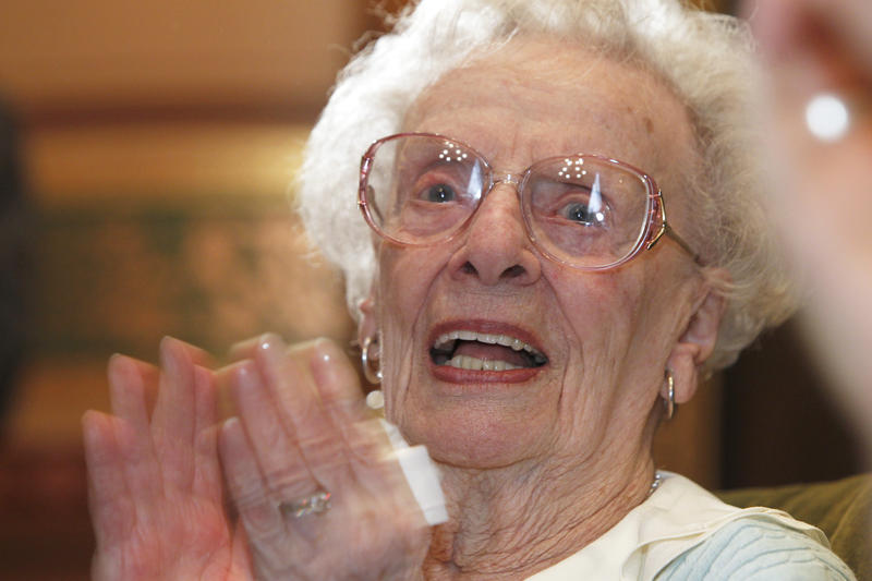 Lola Aiken, pictured here at a celebration for her 100th birthday, died Monday at age 102.