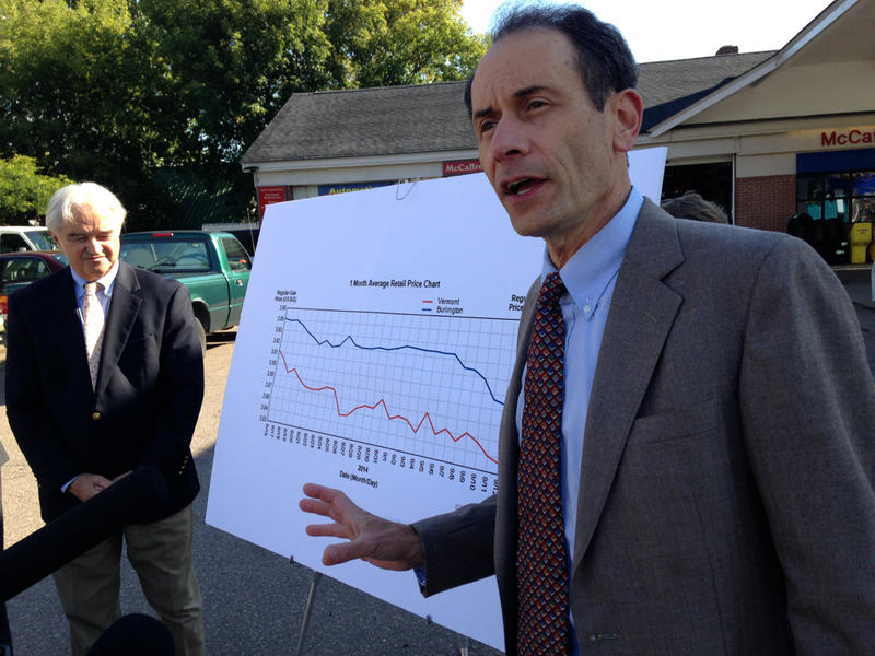 Dean Corren, right, explained a graph showing the gap between Burlington gas prices and the statewide average.