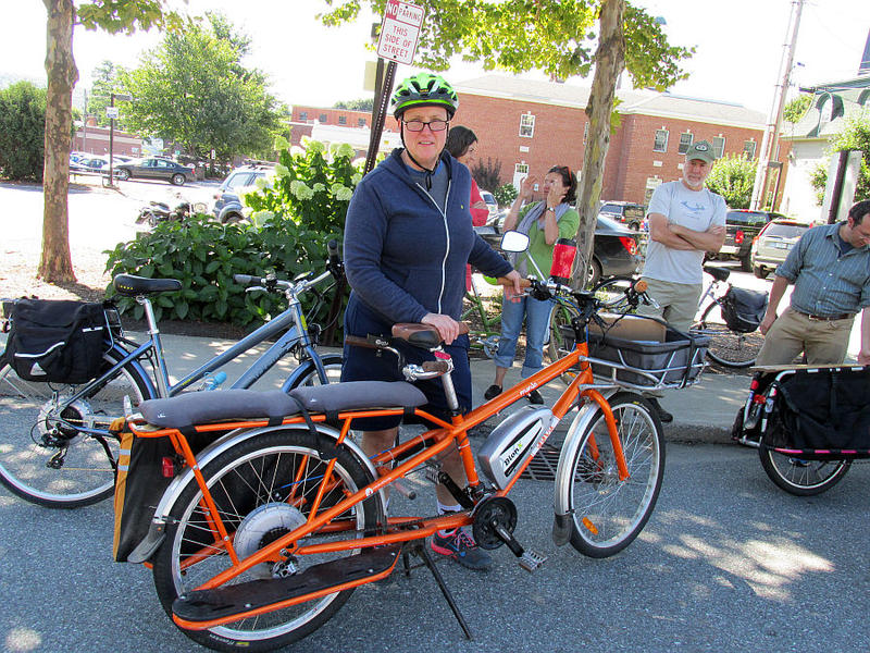 Brattleboro Bike Store co-owner Barb Walsh rides a Prodeco Tech electric bike.