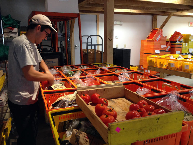 Bobby Young of Intervale Food Hub prepares a delivery for UVM students