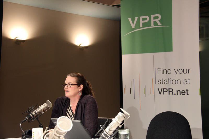 VPR's Jane Lindholm welcomes guests to the table.
