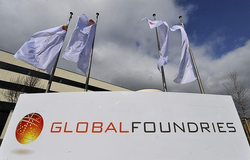 Flags fly at a GlobalFoundries location in Dresden, Germany in 2009. Some are speculating that the Abu-Dhabi controlled company may be for sale; the company took over IBM's plants in Essex Junction and East Fishkill, New York, earlier this year.