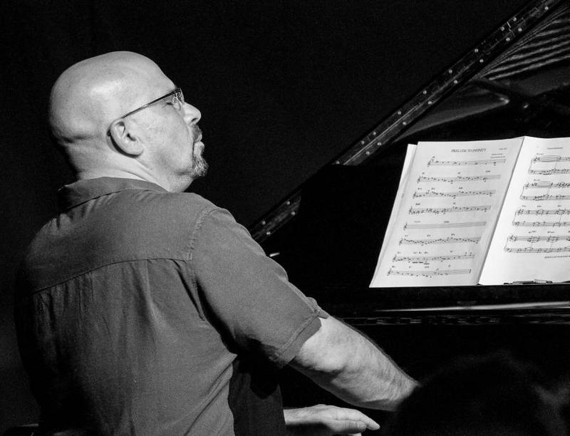 Vermont Jazz Center Director Eugene Uman loves playing piano in the center's performance space.