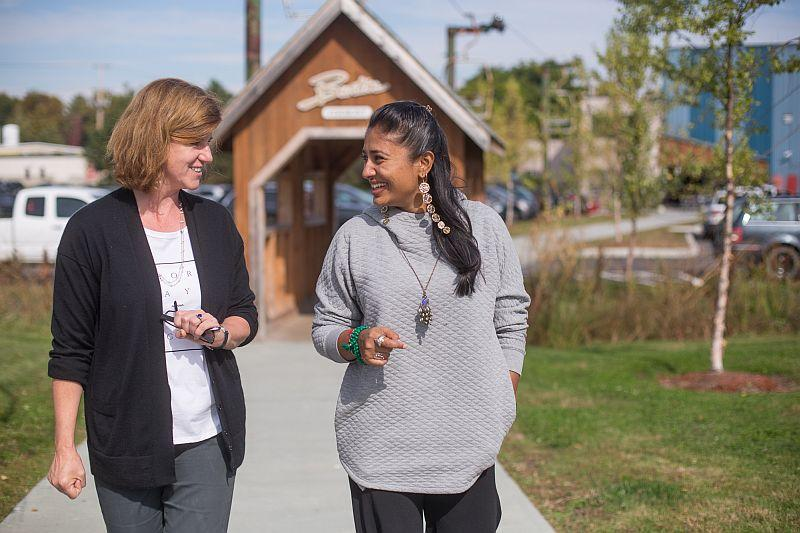 Donna Carpenter, left, and Wasfia Nazreen, right, outside Burton Snowboards in Burlington, where Nazreen had a month-long mentorship with Carpenter.