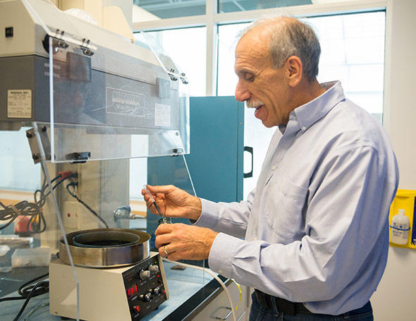 Professor Joe BelBruno spin-coats polymer film onto interdigitated electrodes to make a sensor chip.