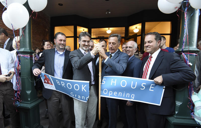 Gov. Peter Shumlin officially opens the renovated downtown block with Bob Stevens, a leader of the restoration effort. Far left, investor Ben Taggard, far right Pete Richards, another key investor.