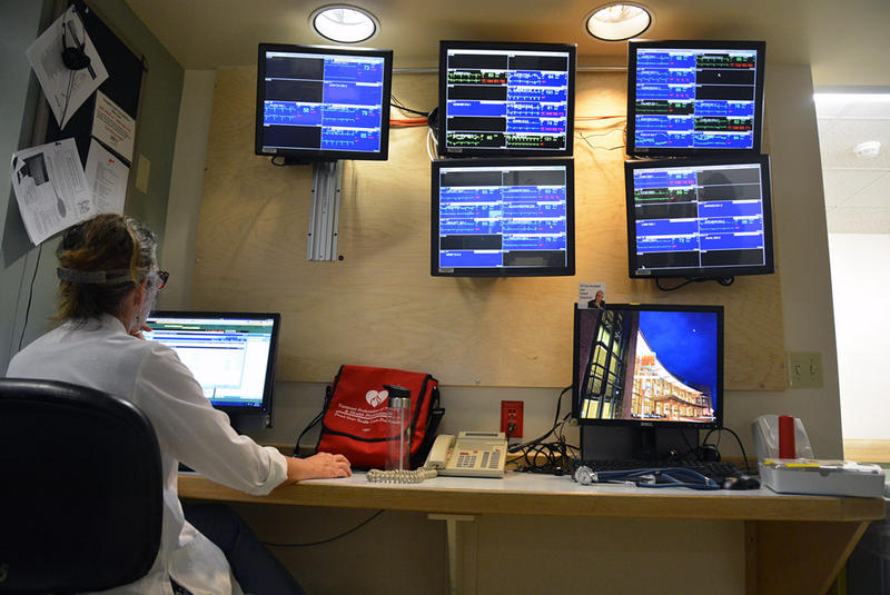A Fletcher Allen employee works under a wall of screens monitoring patients' heart conditions on October 6. Dr. Kemper Alston says the hospital is prepared for the potential arrival of Ebola in Vermont.
