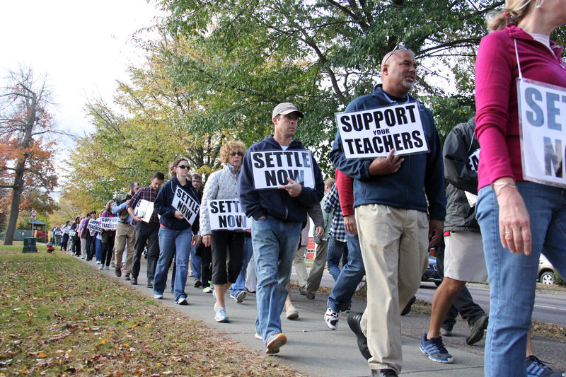 South Burlington teachers walk the picket line during a strike in October of 2014. A new bill would ban such strikes, prohibit school boards from imposing contracts and call for binding arbitration in a contract dispute.
