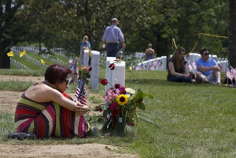 Natasha Marshall, 22, of Frederick, Md., visits the grave of her friend and high school sweetheart Army Specialist Tyler Hammett, 21, in Section 60 on Memorial Day 2014.