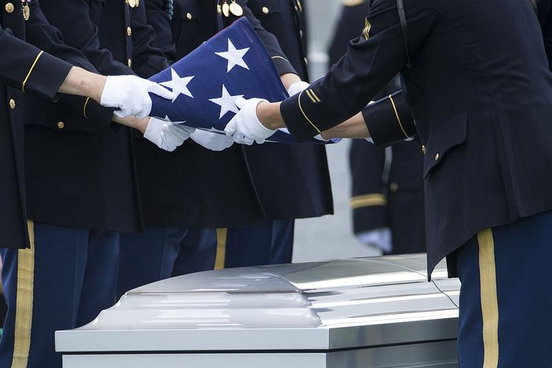 A flag is folded over the casket of Army Maj. Gen. Harold Greene during his burial service in Section 60 at Arlington National Cemetery in August 2014. Greene is the highest-ranking U.S. military officer to be killed in America's post-9/11 wars.