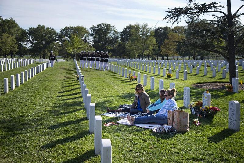 Amanda Justice of Grimes, Iowa, center, visits the grave of her husband Army Staff Sgt. James Justice in Section 60, who was killed in Afghanistan on April 23, 2011.